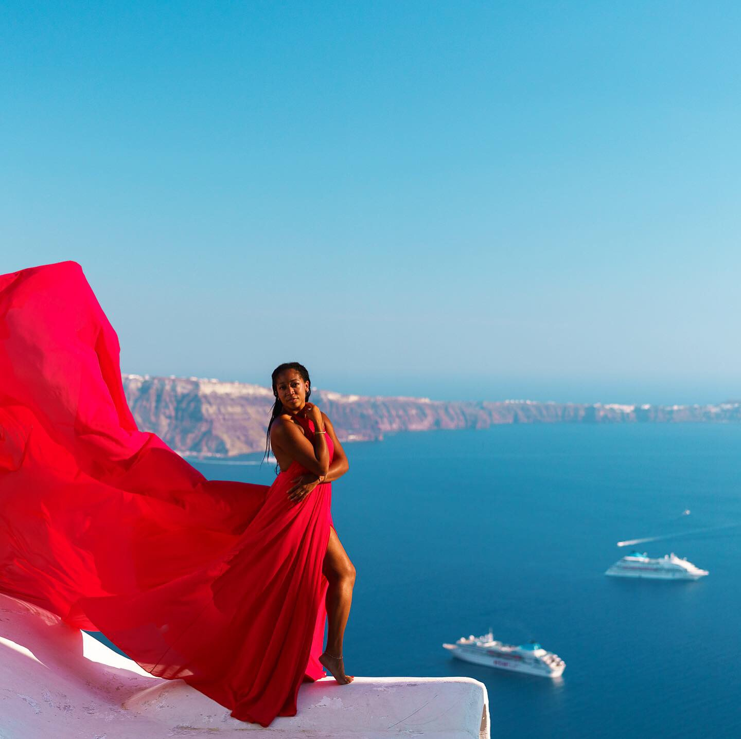 "The Scoop on Those Famous Santorini ""Flying"" Dress Pictures"